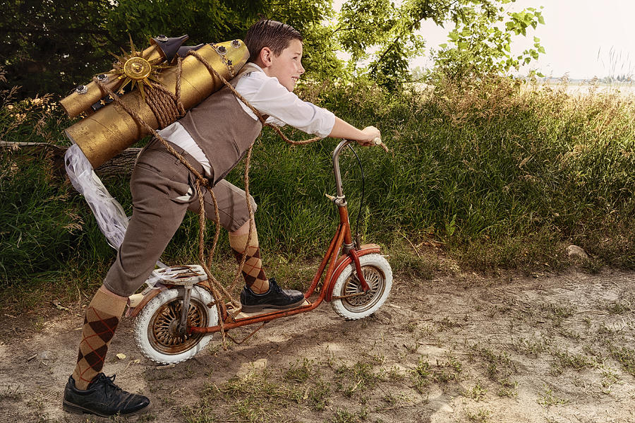 vintage-boy-with-toy-space-rocket-and-scooter--imagination-kriss-russell